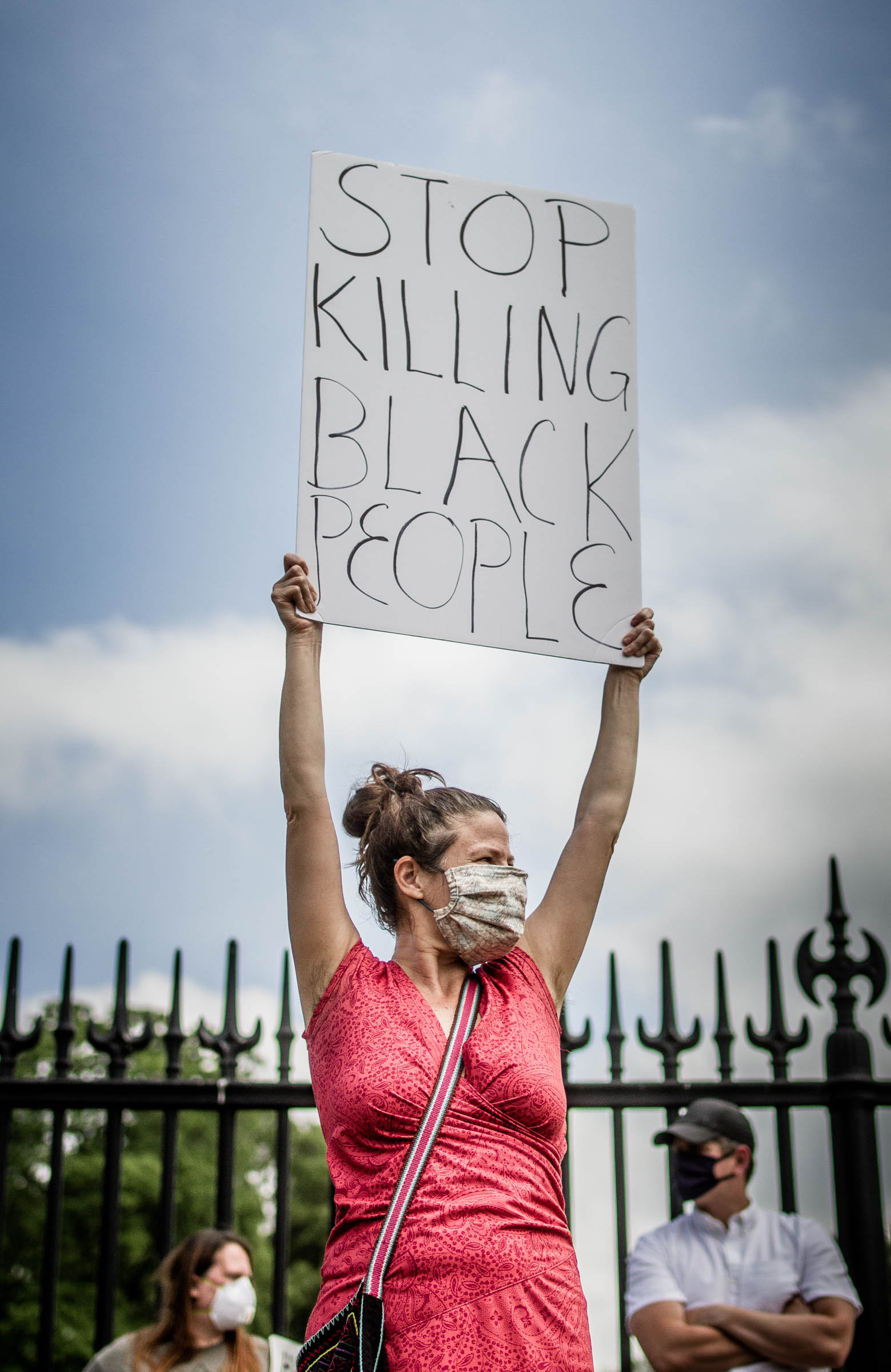 A protestor holds up a placard at the George Floyd protest in Springfield MA, May 29, 2020